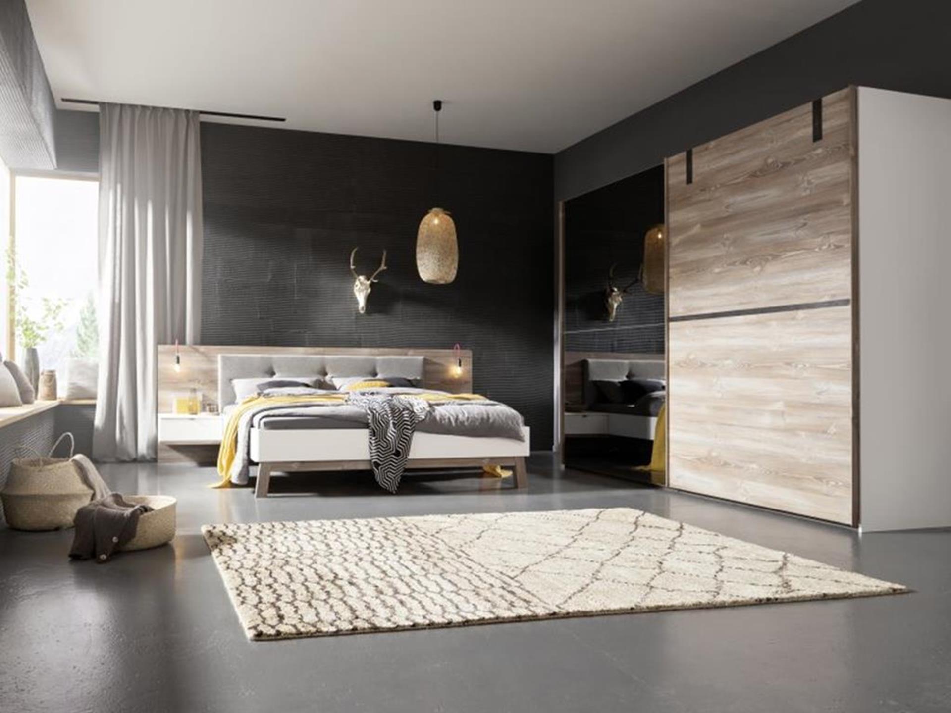 łóżko, szafka nocna i szafa w eleganckim niemieckim wydaniu